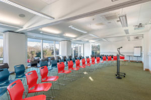 The Education & Conference Centre at Arthur Rank Hospice Charity set up as a Conference Room with a maximum capacity of 90 people. The room can also be divided into two or three smaller spaces.