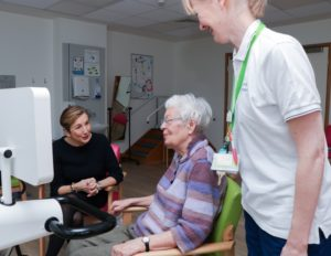 Arthur Rank Hospice Charity's new President, Lady Chadwyck-Healey (right) meets to Day Therapy patient Eileen (middle) and Joint Day Therapy Lead Sue Rossiter in the Hospice's physiotherapy gym.