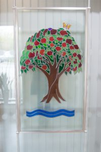 Arthur Rank Hospice Royal stained glass window displayed in Evelyn Day Therapy Window