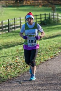 Jane Clarke a nurse at the Alan Hudson Day Treatment Centre taking part in the Arthur Rank Hospice Charity Ely Festive 5K in 2017