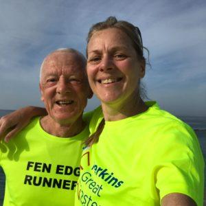 John and Wendy in their luminous yellow running tops