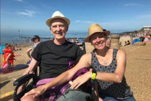 Wendy and John with sunhats on, on Hunstanton beach