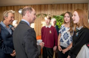 : (Right to left) Alice Webb, Jodie Lawler and Morgan Larter tell The Earl more about the volunteering work they are undertaking in the Hospice's charity shops as part of their Duke of Edinburgh Award