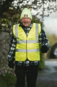 George Ginn walking in his high vis vest for Step A Million