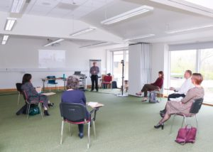 Colleagues at the Arthur Rank Hospice Charity are given a training session on the new video conferencing equipment, which was funded by Citrix and has been installed to the facility during the third lockdown.