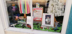 Miniature Porsches sold at Arthur Rank Hospice Charity shop in Regent Street, Cambridge to highlight Stephen Hughes's challenge to Norway in a Porsche 944.