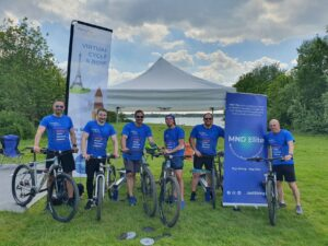 Lee and his friends dressed in blue t-shirts with their cycles fundraising for MND.