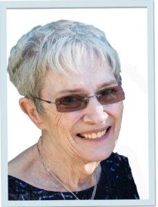 Headshot of Laine wearing sunglasses
