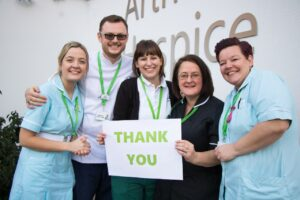 Clinical Staff at Arthur Rank Hospice holding a Thank you sign
