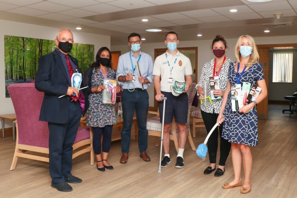 Some of the MND team, wearing masks and holding various equipment and aids